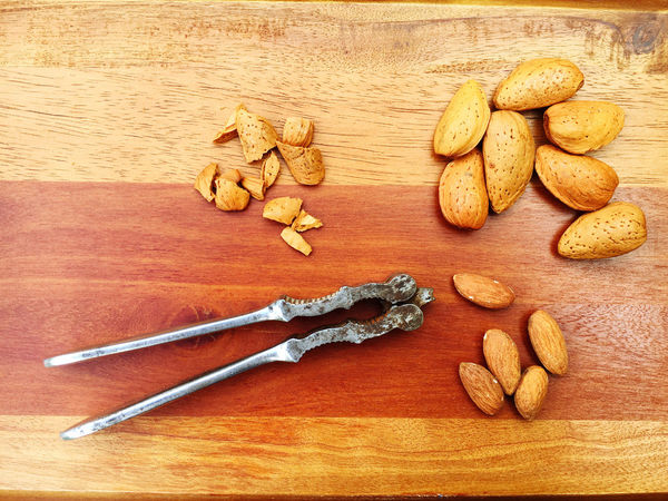 Almonds Brown Close-up Cutting Board Directly Above Elevated View Food Freshness Kitchen No People Nut Cracker Nut Cracking Nuts Overhead View Still Life Table Wood Wood - Material Wooden