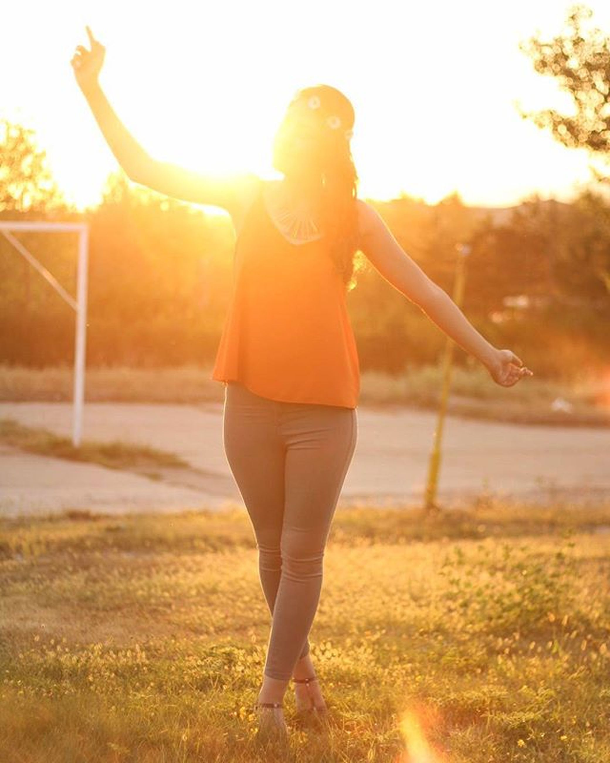 lifestyles, full length, leisure activity, sun, sunlight, sunset, sunbeam, lens flare, casual clothing, standing, grass, sky, person, enjoyment, field, carefree, childhood, fun
