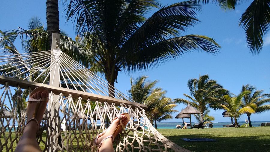 Summer Relaxation Hammock Seaside Hotels And Resorts Mauritius Island  One Person Human Body Part Personal Perspective