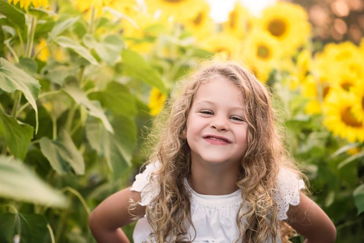 Portrait of smiling girl against plants