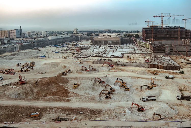 Architecture Cityscape Doha,Qatar Cranes And Construction High Angle View Excavators Built Structure Big Construction Site City Industry Construction Industry Development Machinery Construction Site Building Exterior No People Building Outdoors Sky Day Travel