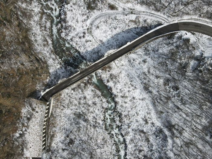 High angle view of snow covered bridge
