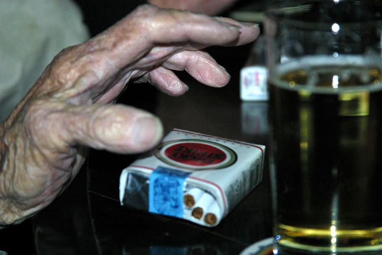 Bar Scene Beverage Cigarettes Cigarettes And Beer Close-up Coffee - Drink Cropped Cup Focus On Foreground Freshness Leisure Activity Lifestyles Lucky Strike Old Hand Part Of Person Reaching For A Cigarette Reaching For A Smoke Refreshment Selective Focus Smoker Still Life Unrecognizable Person