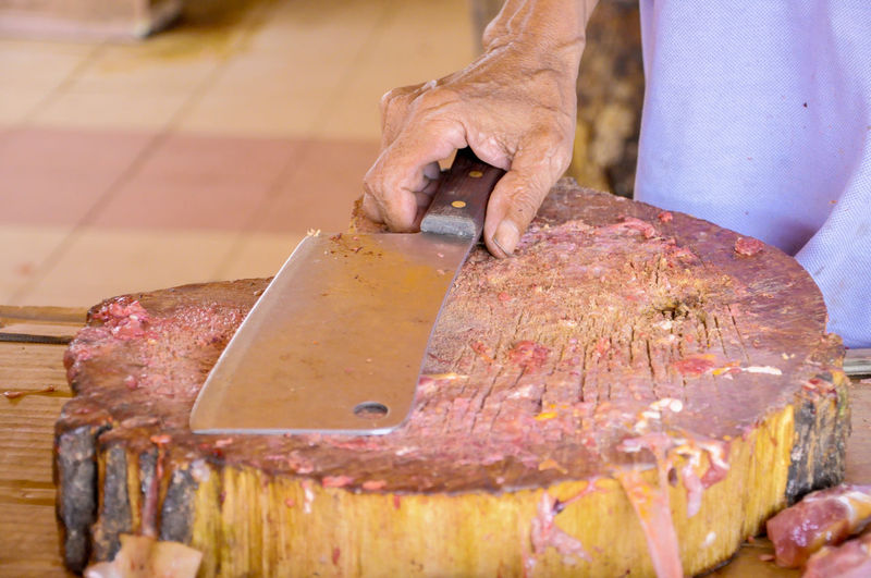 Cropped Image Of Butcher In Butchers Shop