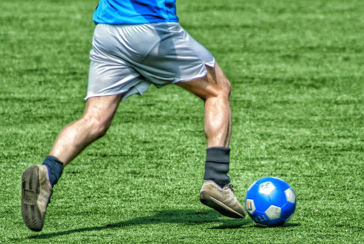 sport, ball, grass, sportsman, soccer ball, soccer, playing, green color, one person, competitive sport, leisure activity, men, one man only, only men, human body part, sports clothing, competition, soccer field, outdoors, team sport, professional sport, day, soccer player, adults only, golf, adult, golf course, athlete, close-up, people, soccer shoe