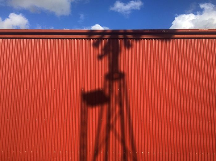 Shadow Cloud - Sky Built Structure Sky Day Nature Pattern Red Architecture Building Exterior Wall - Building Feature Corrugated Iron Shadow No People