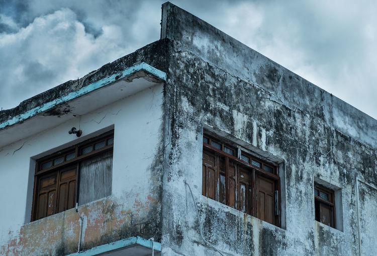 Architecture Building Building Exterior Built Structure Cloud Cloud - Sky Cloudy Day Deterioration Exterior Façade House Low Angle View No People Old Outdoors Residential Building Residential Structure Sky Window Wood
