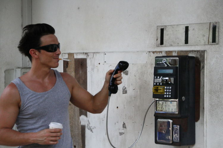 Man using payphone