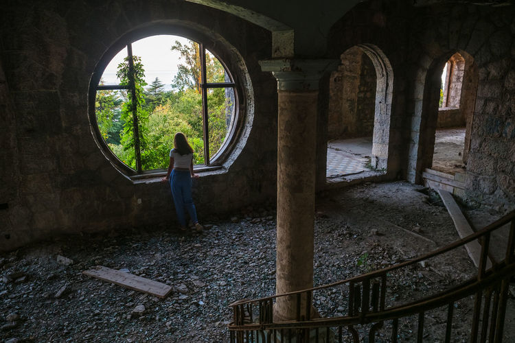 Man standing in old abandoned building