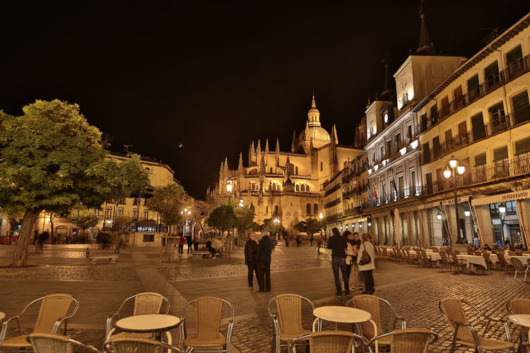 A night view of the Plaza Mayor in Segovia in Spain Architecture Building Exterior Built Structure Capital Cities  City City Life Community Culture Façade Famous Place History Incidental People International Landmark Old Town Outdoors Place Of Worship Spain, Madrid, Tourism, Tourist, Buildings Town Square