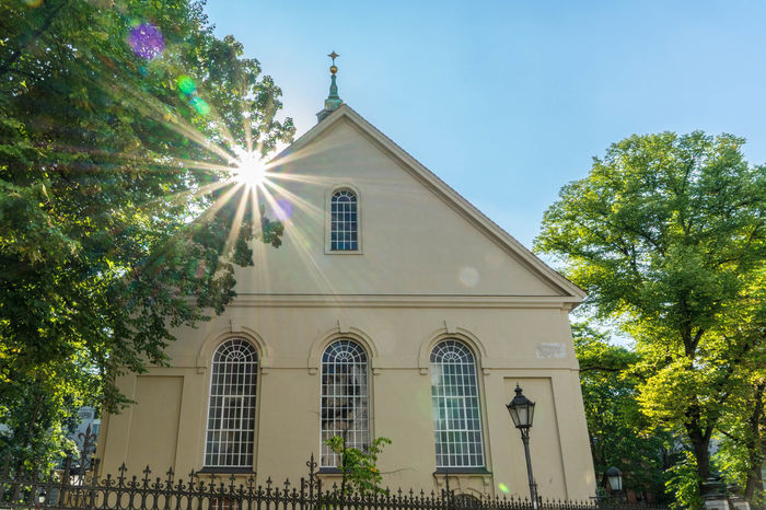 Sophien-Church in Berlin, Germany. Near the Hackescher Markt Architecture Belief Building Building Exterior Built Structure Day Hackeschermarkt Low Angle View Nature No People Outdoors Place Of Worship Plant Religion Sky Spirituality Sunbeam Sunlight Tree