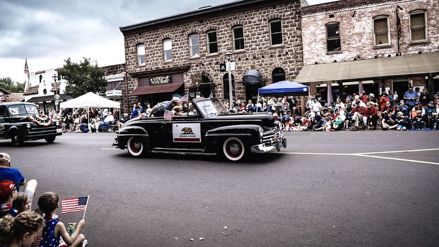 Bear Flag Sonoma Strong Parade 4th Of July American Flag Classic Car City Land Vehicle Transportation Architecture Street Mode Of Transportation Building Exterior Built Structure Group Of People Motor Vehicle City Street Road Car Crowd Real People The Street Photographer - 2018 EyeEm Awards