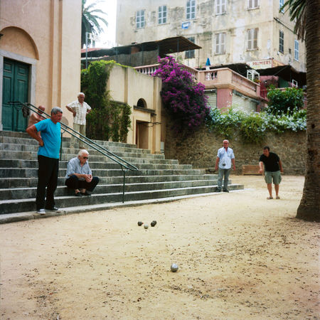 Ile-Rousse, France. Analogue Photography Boules Corse France Palm Stairs Architecture Building Exterior Corsica Day French Game Group Of People Hobby Leisure Activity Men Outdoors Petanque Play Playing Real People Sport Town Town Square Tree EyeEmNewHere Done That. The Week On EyeEm