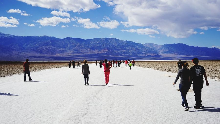 People at badwater basin on sunny day