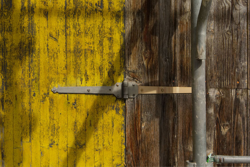 Detail building site Hinge Backgrounds Buliding Site Close-up Day Door Entrance Framework Full Frame Latch Metal Metallic No People Outdoors Protection Safety Security Textured  Weathered Wood - Material Yellow