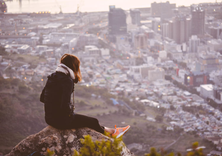 Casual Clothing Focus On Foreground Full Length Leisure Activity Lifestyles Outdoors Person Rear View Shoe Sitting Sunrise View The Great Outdoors With Adobe