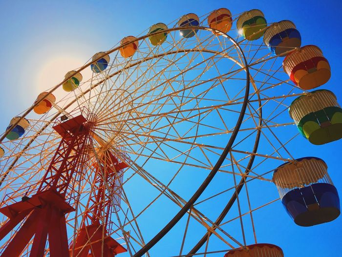 Low Angle View Of Multi Colored Ferris Wheel Against Clear Sky