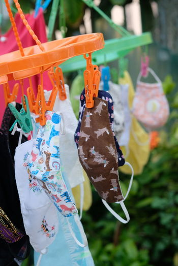 Close-up of multi colored clothespins hanging on market stall