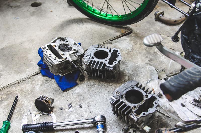 High angle view of vehicle parts at garage