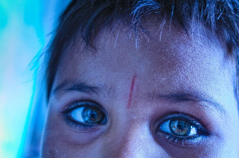 Close-up portrait of woman with blue eyes
