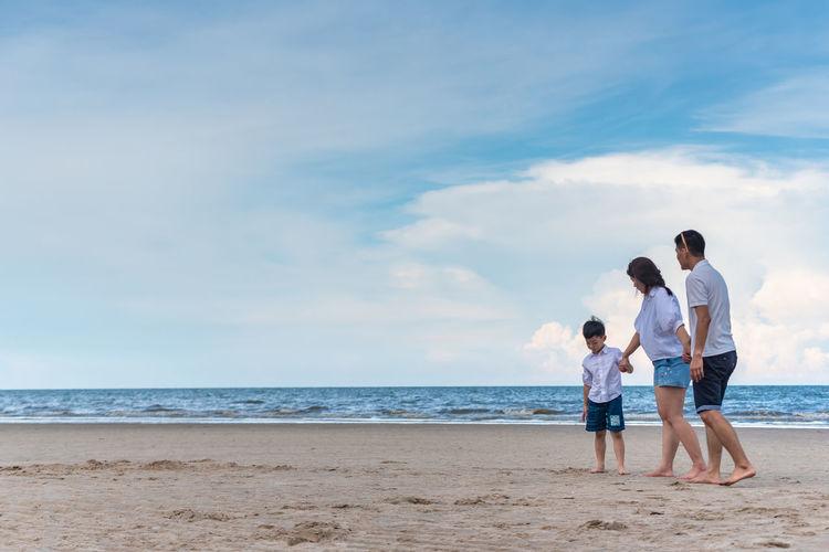 Full length of family walking at beach