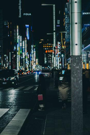 Illuminated city street at night