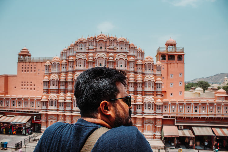 Man against hawa mahal in city