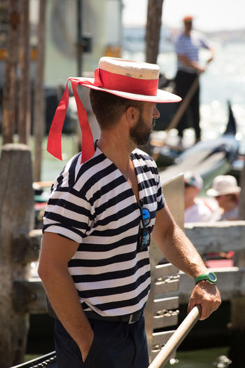 A Day in Venice Day Focus On Foreground Gondolas Gondolier Hat One Person Outdoors Side View Standing Striped Travel Destinations Travel Photography