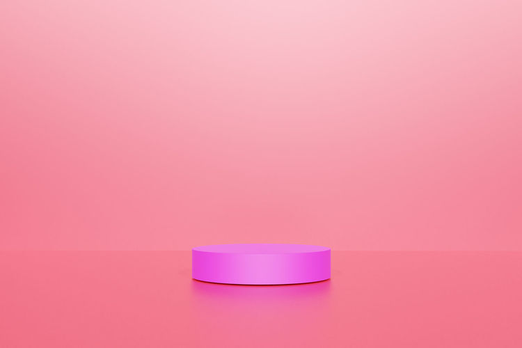 Close-up of pink candle against white background