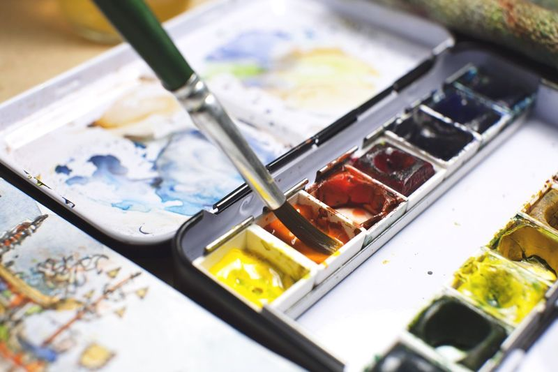 Close-up of paint with brush