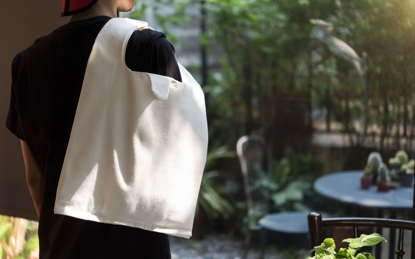 Rear view of man holding bag