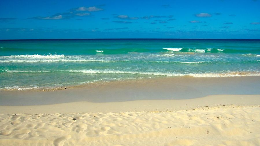 Sea Beach Sand Blue Horizon Over Water Sky Water Scenics Tourism Nature Beauty In Nature Travel Destinations Vacations Cloud - Sky Outdoors Coastline Tranquility No People Day Wave Varadero, Cuba Varadero Beach - Cuba Caribbean Sea Caribbean Simple