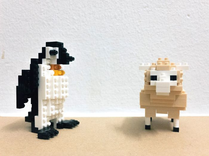 Pingu and Sheep, Brixies Figures Nanoblock Penguin Sheep Brixies EyeEm Selects Creativity No People Nature Wall - Building Feature Indoors  Built Structure Toy Mammal Art And Craft White Color Representation Balance Animal Shadow