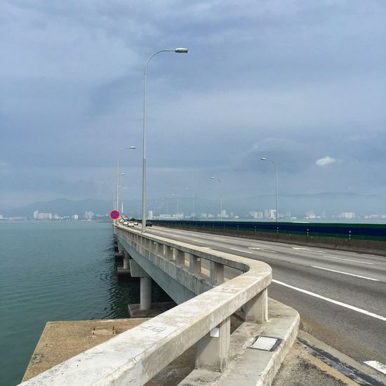 The bridge across the sea to Penang Penang Malaysia ASIA Sky Fog Transport Road Outdoors Beach Water Day Cloud - Sky No People Sea Industry Business Finance And Industry Harbor Built Structure Travel Destinations Sky Nautical Vessel Photography Themes City Urban Skyline Cityscape EyeEmNewHere An Eye For Travel