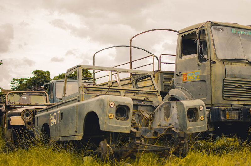 Veteran Field Land Vehicle Land Sky Plant Nature Grass Day Mode Of Transportation Abandoned Transportation Obsolete Cloud - Sky Damaged No People Outdoors Run-down Metal Motor Vehicle Old Deterioration Junkyard