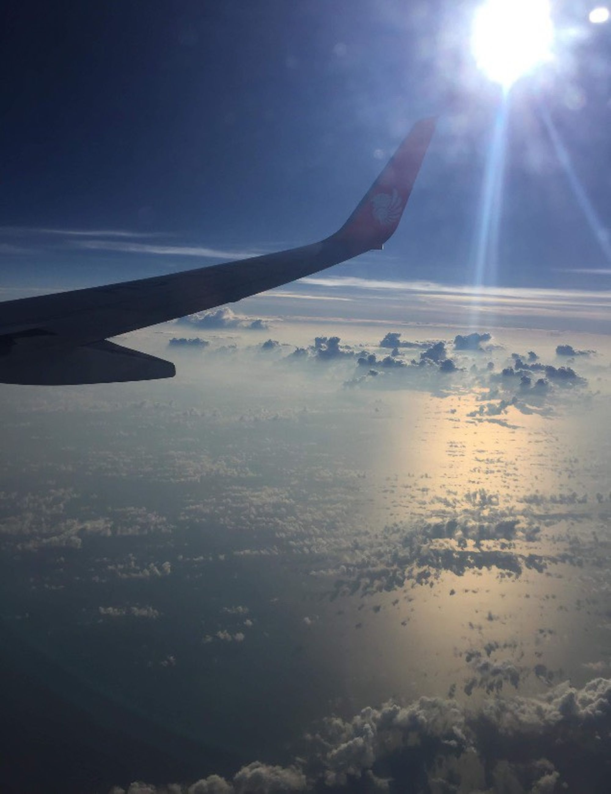 airplane, airplane wing, sky, transportation, aerial view, sun, air vehicle, sunbeam, nature, journey, flying, lens flare, cloud - sky, mid-air, aircraft wing, sunlight, beauty in nature, no people, scenics, mode of transport, outdoors, travel, day, sunset