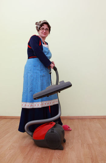 Woman using the vacuum cleaner. Cleaning EyeEm Best Shots Housewife Housework Active Activity Casual Clothing Floor Hardwood Floor Home Interior House Housewife Life Indoors  Lifestyles One Person Person Real People Vacuum Cleaner