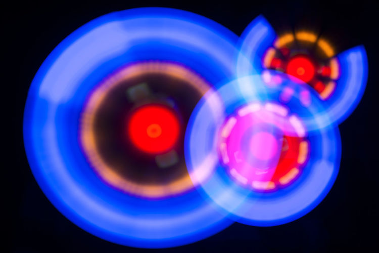 Three circles glowing spiral with swirling light, shine round blue frame with light circles light effect No People Circle Geometric Shape Blue Shape Motion Turning Spinning Nightlife Night Light - Natural Phenomenon Circle Glowing Spiral Swirl Light Shine Round Effect Ring Energy Speed Central