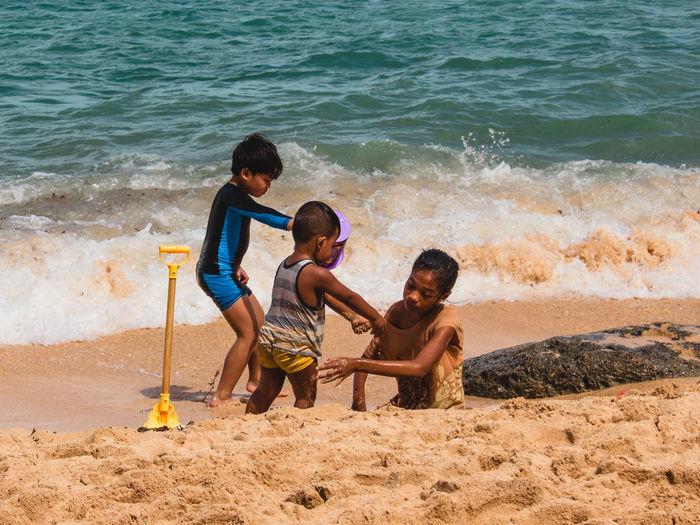 Full length of friends on beach