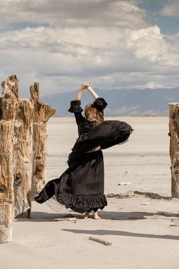 Portrait of woman dancing in desert
