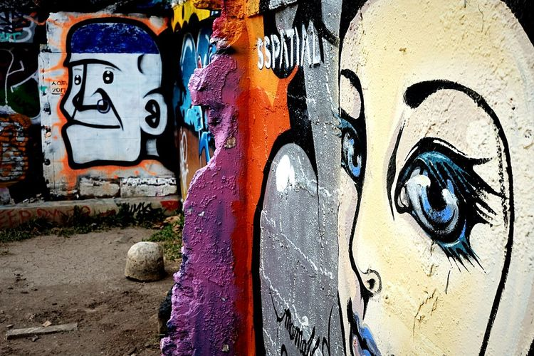 Art Is Everywhere Graffiti Spray Paint Street Art Creativity Aerosol Can Outdoors Paint Multi Colored No People Close-up Built Structure