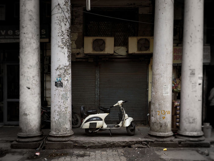 Motor scooter against buildings in city