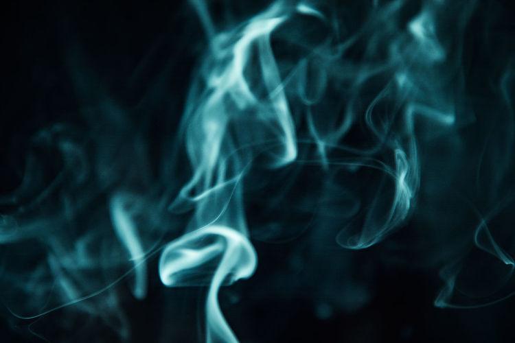 Close-up of smoke emitting from black background
