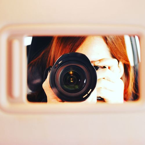 Close-up of woman photographing