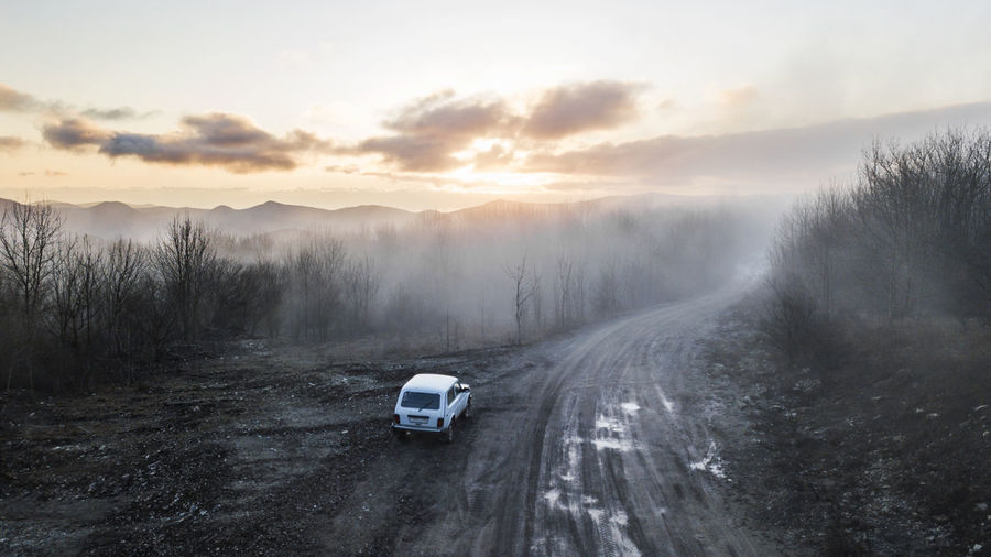 4x4 Nature Sunlight Adventure Beauty In Nature Car Day Fog Forest High Angle View Land Vehicle Landscape Mist Mountain Nature No People Outdoors Road Scenics Sky Sunrise Sunset The Way Forward Transportation Tree