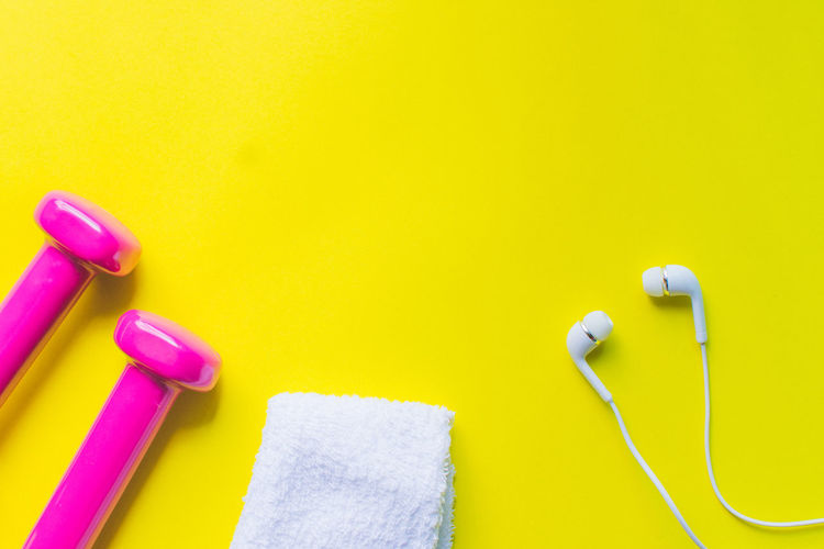 Yellow Indoors  Studio Shot No People Colored Background Hygiene Still Life Copy Space Close-up Choice Yellow Background Vibrant Color Group Of Objects Bathroom Body Care Pink Color Domestic Bathroom Music Wall - Building Feature Care Clean Small Group Of Objects Fitness Equipment