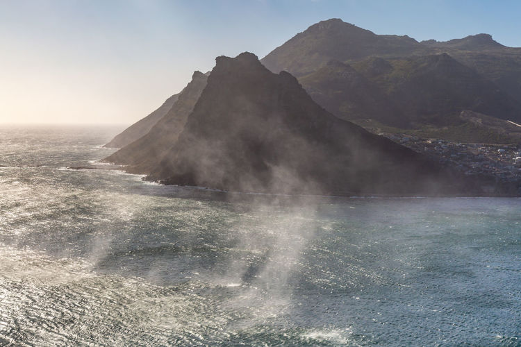Sea spray over the water at Hout Bay, South Africa Cape Peninsula Cape Town Hout Bay Sea Spray Beauty In Nature Clear Sky Day Geology Idyllic Land Landscape Mountain Mountain Peak Nature No People Non-urban Scene Outdoors Physical Geography Power In Nature Scenics - Nature Sky Sunlight Tranquil Scene Tranquility Water