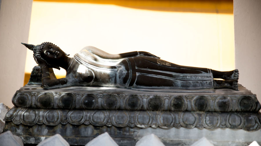 Buddha Image Buddha Statue Close-up Day Honor Indoors  No People Pray Religion Sculpture Sleeping Statue Temple Tueday Worship