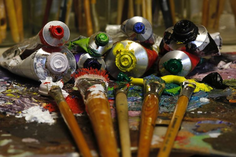 Close-up of paintbrushes and tubes