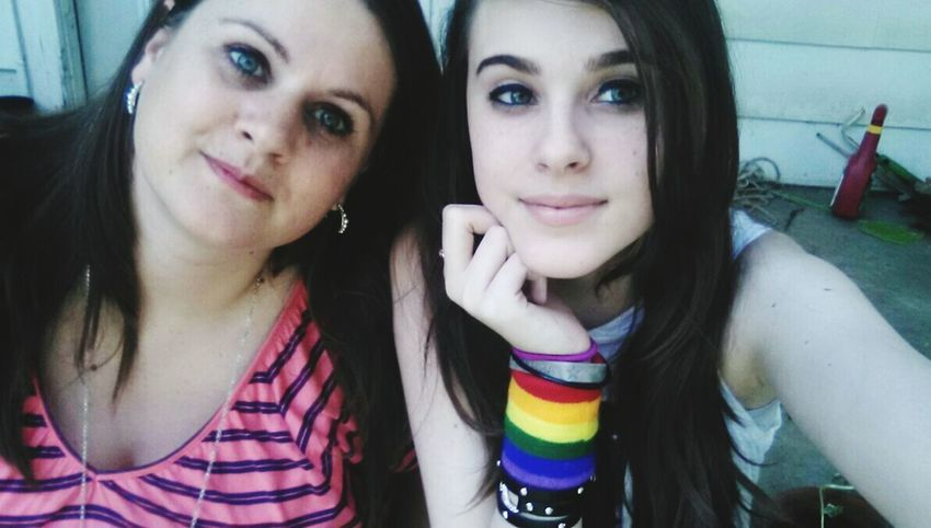 My mini-me ! My Daughter My Daughter And Me My Beautiful Daughter My Mini Me Taking Photos Posing For The Camera Posing Rainbow Colors Rainbow Bracelet Bracelet Love Brown Hair Earrings And Braclet Earrings